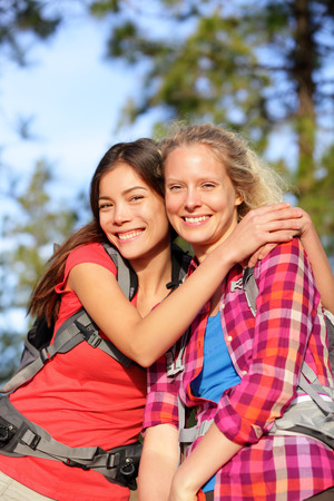best group: Girlfriends. Happy young women hiking portrait of smiling multiracial friends