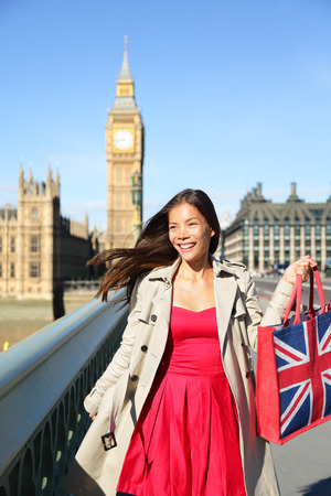 London woman tourist shopping bag near Big Ben.  photo
