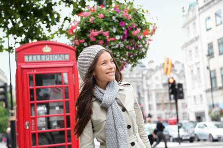 phonebooth: People in London- woman by red phone booth.