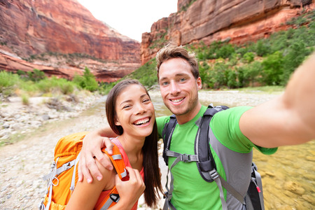 Travel hiking selfie self-portrait photo by happy couple on hike. photo