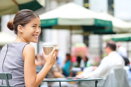 chinese people: Young business woman coffee break in city park drinking coffee.  Stock Photo