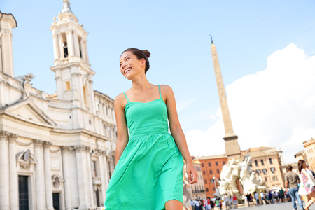 navona: Woman in green dress in Rome on Piazza Navona. Young tourist on vacation travel smiling happy walking joyful in Italy, Europe. Stock Photo