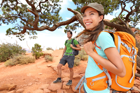 Hiker in Grand Canyon. Hiking woman and man resting enjoying hike and view on South Kaibab Trail, south rim of Grand Canyon, Arizona, USA.
