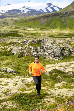 running pants: Trail running man in cross country run. Fit male runner training jogging outdoors in beautiful mountain nature landscape with Snaefellsjokull, Snaefellsnes, Iceland.