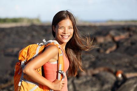 kilauea: Hiking woman - hiker walking on lava field on Hawaii. Tourist on hike near Kilauea volcano around Hawaii volcanoes national park, USA.