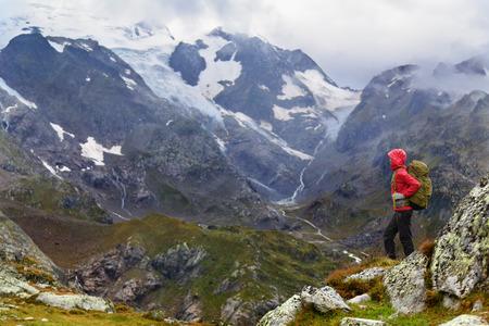 Hiking - hiker woman on trek with backpack living healthy active lifestyle. Hiker girl walking on hike in mountain nature landscape in Steingletscher, Urner Alps,Ã' Berne,Ã' Swiss alps, Switzerland. Standard-Bild