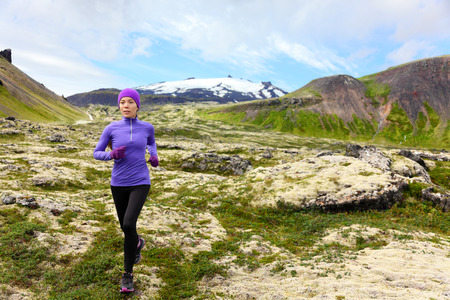 ultra: Athlete trail runner - running woman exercising. Fit female sport fitness model training jogging outdoors living healthy lifestyle in beautiful mountain nature, Snaefellsjokull, Snaefellsnes, Iceland. Stock Photo