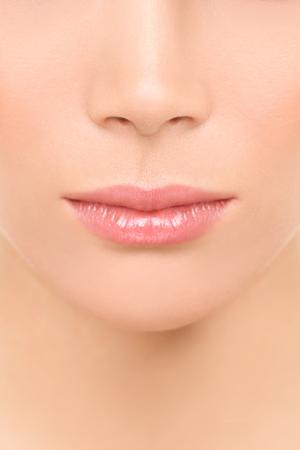 Mouth and nose closeup - beauty face woman. Beautiful lips closeup of mixed race Asian Caucasian beauty model.