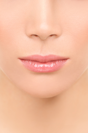 balm: Mouth and nose closeup - beauty face woman. Beautiful lips closeup of mixed race Asian Caucasian beauty model.