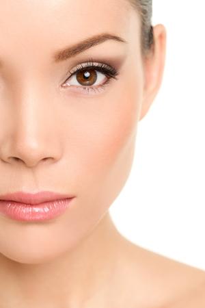 eyebrow makeup: Beauty face closeup - Asian woman eye makeup concept with mascara smokey eyeshadow and eyeliner