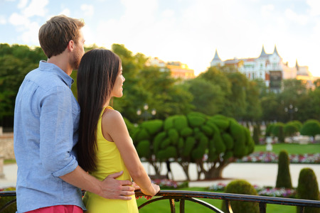 parque del buen retiro: Romantic couple embracing in love enjoying view in park. Multicultural man and woman relaxing in el Retiro in Madrid, Spain, Europe. Stock Photo