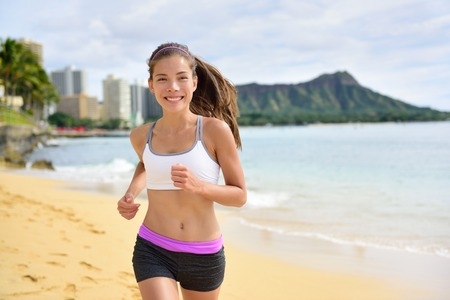 Running sport fitness woman jogging on beach run. Female athlete runner jogger training living healthy active exercise lifestyle exercising outdoor on Waikiki Beach, Honolulu, Oahu, Hawaii, USA. 스톡 콘텐츠
