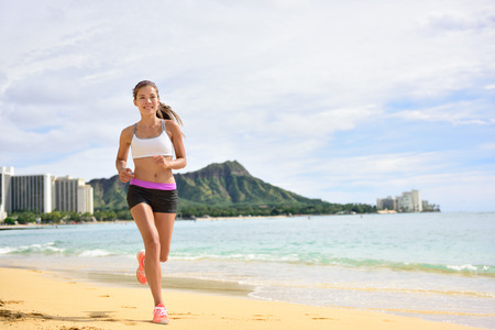waikiki beach: Sport running fitness woman jogging on beach run. Female athlete runner jogger training living healthy active exercise lifestyle exercising outdoor on Waikiki Beach, Honolulu, Oahu, Hawaii, USA.