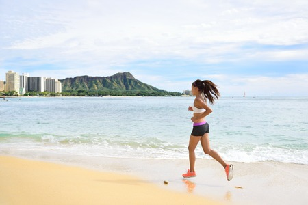 hawaiian girl: Woman runner - Sport running fitness girl jogging on beach run Female athlete jogger training living healthy active exercise lifestyle exercising outdoor on Waikiki Beach, Honolulu, Oahu, Hawaii, USA. .