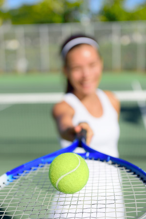 tennis player: Tennis. Woman tennis player showing ball and racket on tennis court outside. Female tennis player. Stock Photo