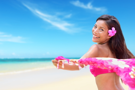 pink bikini: Beach woman in bikini happy on vacation paradise beach waving scarf sarong in wind happy in on travel holiday in tropical Hawaii an beach. Beautiful biracial Asian Caucasian girl.
