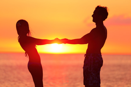 silhouette couple holding hands at beach stock photo picture and royalty free image image 44395843