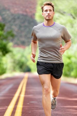 Man running on road.