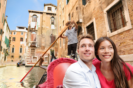 asian lady: Romantic travel couple in Venice on Gondola ride romance in boat talking happy together on travel vacation holidays.