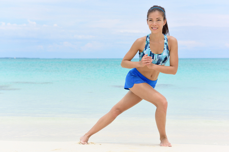 lunges: Fitness woman doing side lunges exercises to do leg strength training. Asian athlete working out her leg muscles to tone butt and glutes with bodyweight core workout.