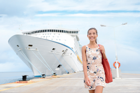 cruise: Cruise ship travel going shopping in port on travel cruise vacation at sea. Happy mixed race Asian Chinese Caucasian woman in dress by luxury cruise liner boat.