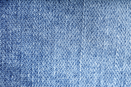 jeans texture: Jeans texture background - worn jean pants fabric of blue washed denim textile. Closeup of fashion cotton weave for background or copy space. Stock Photo