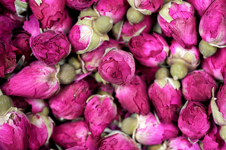 Rose tea - dried rosebuds flowers texture closeup. Dry roses petals for Asian tea and spices. Copyspace for element or background.