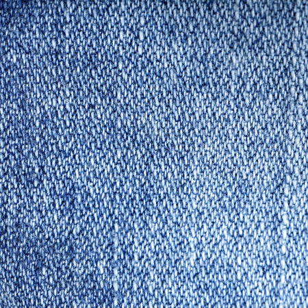 blue lines: Jeans fabric background. Worn jean pants closeup of faded blue denim weave texture with vertical weave lines useful for elements of illustration, text copyspace or backgrounds.