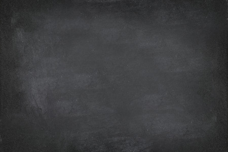 Black Chalkboard blackboard chalk texture background. Black chalk board texture empty blank with writing chalk traces erased on the board. Copyspace for text advertisement. School board display.