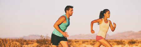 Fitness athletes trail runners couple running on sunset landscape banner crop. Outdoors nature sport training copy space concept.