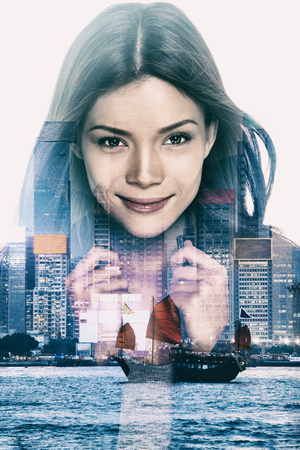 Double exposure urban Asian woman over grunge Hong Kong city background, China, Asia. Creative design effect for movie poster. Cool Chinese girl face closeup with skyscrapers from Hong Kong skyline.