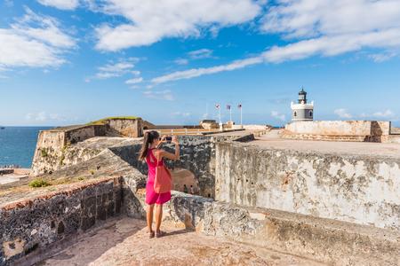 Puerto Rico travel tourist woman in San Juan, at the fort Castillo San Felipe Del Morro, famous attraction of Old San Juan city in Puerto Rico, USA. Summer holidays. Stock Photo