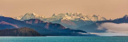 Alaska inside passage cruise landscape panorama of nature background. Alaskan mountain range in Glacier Bay, Alaska, USA. Stock Photo