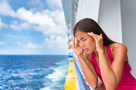 Sea sickness tourist woman seasick on cruise ship travel vacation feeling ill with nausea and headache migraine. Holiday anxiety or fear, seasickness concept.