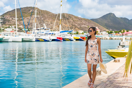 Woman tourist walking in Philipsburg harbor, St Maarten, popular port of call for cruise ship travel destination. Netherlands Antilles.