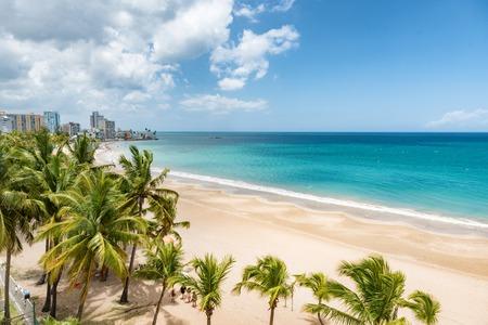 Beach travel Caribbean vacation landscape of Puerto Rico background. Isla Verde in San Juan, Latin America island.