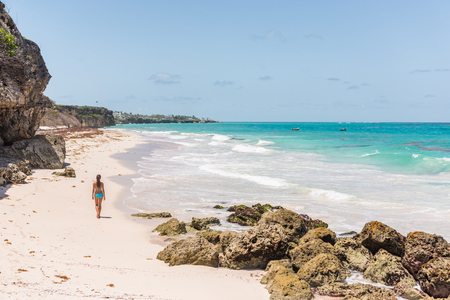 Barbados beach girl on cruise vacation walking at Ginger beach famous tourist travel destination. Stock fotó