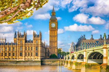 London Europe travel destination, Big Ben and Westminster parliament in autumn with foliage. Fall season landscape of famous city.