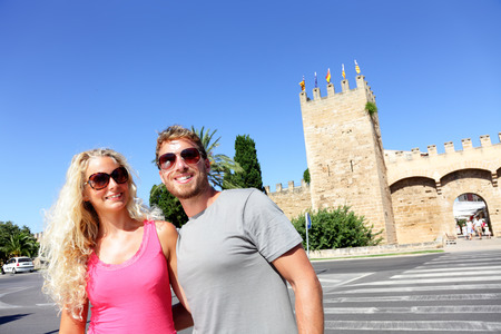 Travel tourists on summer vacation wearing sunglasses. Couple in Mallorca, Spain, spanish cruise destination in the balearic islands. Europe holidays young people lifestyle. Stock Photo