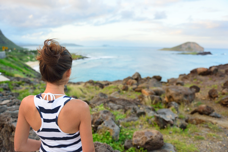 Hawaii travel woman tourist looking at makapuu lookout view of Waimanalo beach.