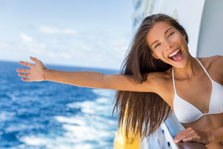 Cruise vacation on cruise travel holiday in caribbean beach. Asian girl with open arm in freedom happy excited. Tourist woman screaming of joy. Happy traveler having fun on summer vacations. Banque d'images