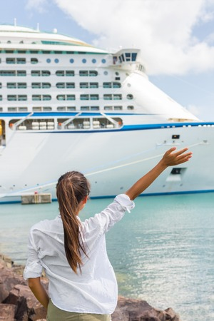 Woman waving hand goodbye at cruise ship leaving. Caribbean luxury travel vacation concept. Boat port of call harbor, people greeting.