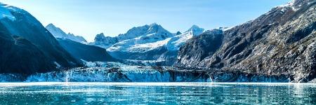 Panoramic view in Glacier Bay from cruise ship cruising towards Johns Hopkins Glacier in summer in Alaska, USA. Banner panorama crop.