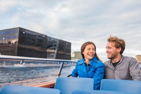 Copenhagen tourists couple on city boat cruise tour enjoying view of the black diamond Royal library, famous architecture building, Denmark, Europe travel. People traveling. Reklamní fotografie