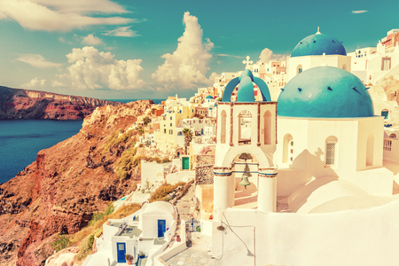Santorini city landscape of luxury travel destination. Cruise tourist popular attraction in Europe for summer holidays. Beautiful scenery of old town with white houses and three domes blue church.