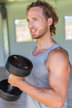 Man lifting weights at home gym. Stock fotó