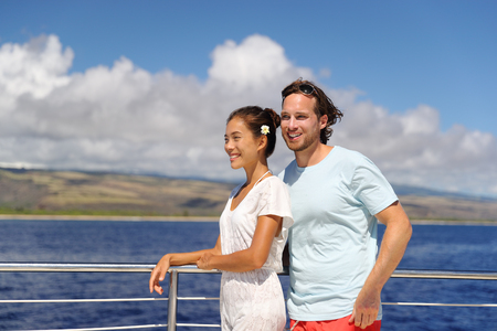 Cruise vacation happy couple relaxing on yacht in Hawaii.