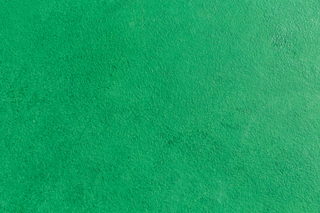 Green metallic chalkboard texture background.