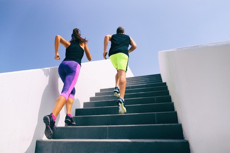 Healthy active lifestyle sport people exercising climbing staircase in urban city.