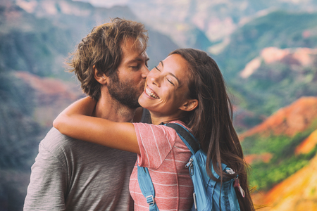 Couple in love kissing on nature travel hiking in mountains.